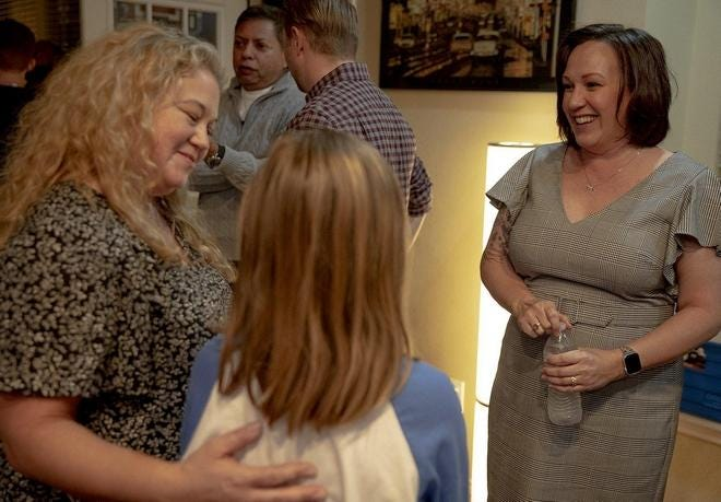Democratic U.S. Senate candidate MJ Hegar speaks with Eilene, left, and Mia Gallo during a campaign event at a North Austin home in January. Hegar's military background appeals to Republicans and Democrats, supporters say.