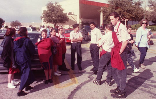 Employees of Luby's Cafeteria in Sunset Mall wait in the parking lot as Police and the Fire Marshal's team check for a reported bomb on Dec. 30, 1995. No bomb was found.