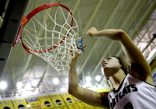 Kalysta Minton-Holland cuts down the net after Water Valley defeated Eden in a playoff game against Eden on Tuesday, Feb. 18, 2020.
