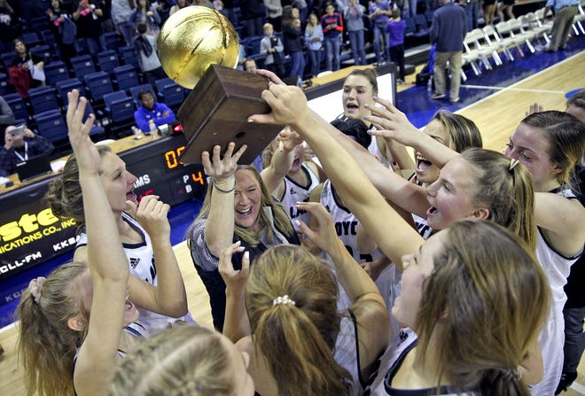 The Water Valley Lady Wildcats celebrate a playoff win against Eden on Tuesday, Feb. 18, 2020.