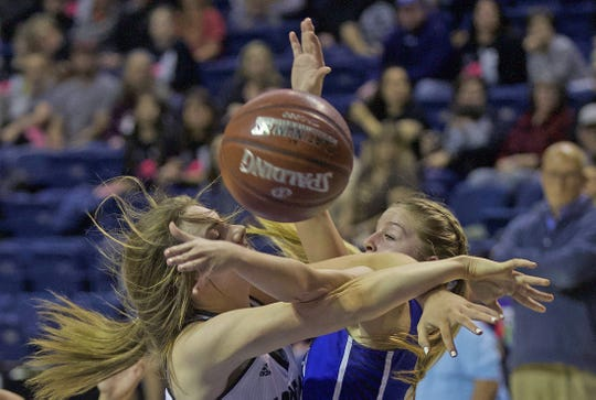 Players for Eden and Water Valley get tangled up chasing a loose ball Tuesday, Feb. 18, 2020.