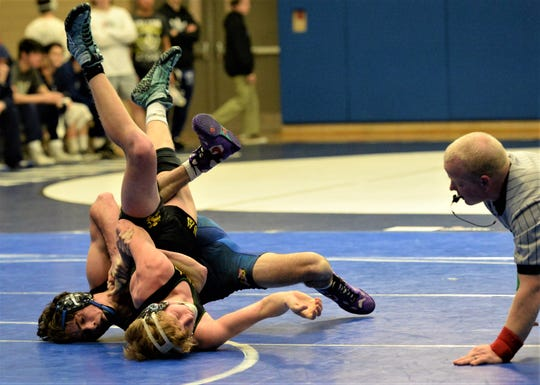 Stephen Decatur wrestler Jagger Clapsadle takes on Queen Anne's Pete Lemmons on Wednesday, Feb. 12, 2020.