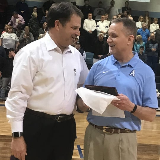Airline athletic director Ronnie Coker and boys basketball coach Chris White share a moment Tuesday night prior to White's final home game as the Vikings' head coach.