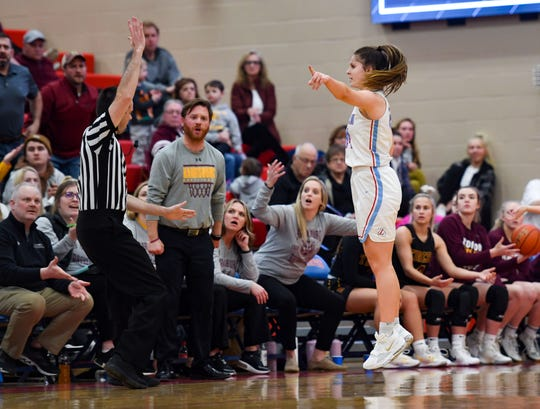 Lincoln's Emma Osmundson jumps and indicates that her team should gain possession after a foul is called on Tuesday, Feb. 18, at Lincoln High School in Sioux Falls.