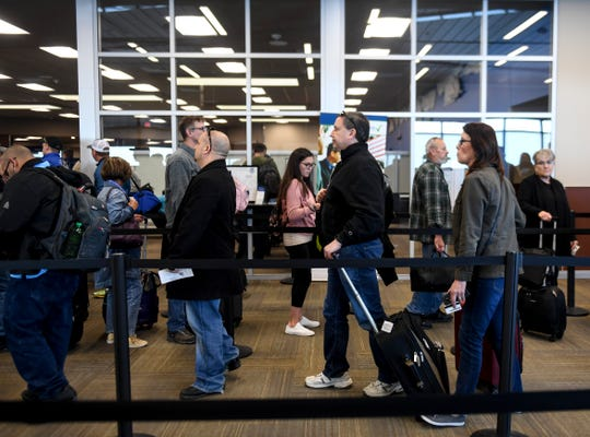 Passengers wait to board their flights on Wednesday, Feb. 19, 2020 at the Sioux Falls Regional Airport.