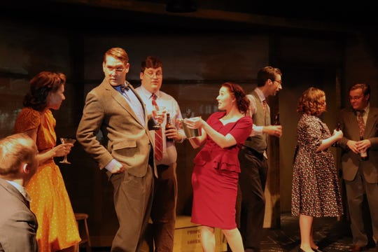 """Party scene with eight cast members in Springfield Contemporary Theatre's """"Oppenheimer."""""""