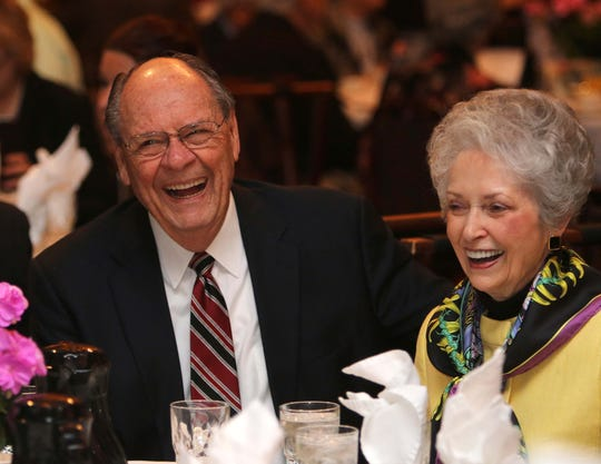 Robert Spence, and his wife, Anne, enjoy a laugh with friends at the Springfield Prayer Breakfast.