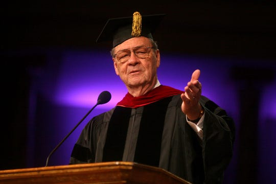Robert Spence, president of Evangel University, speaks during the college's commencement at the James River Assembly.