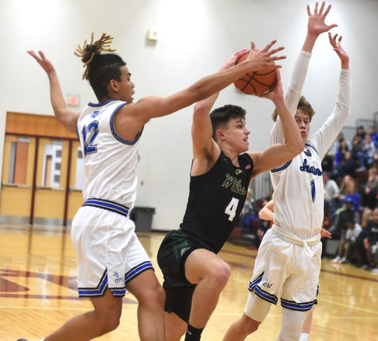Wilson Memorial's Gabe LaGrua gets tries to get past the defense of Fort Defiance's Daniel Torres and Vincent Sipe Tuesday at Stuarts Draft High school in a special playoff game. Wilson won and will advance to the Region 3C tournament.