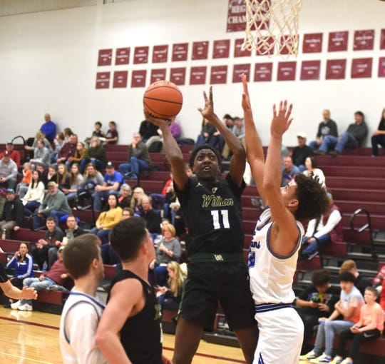 Wilson Memorial's Zakar Woodson (11) finished with 25 points as Wilson beat Fort Defiance to advance to the Region 3C tournament.