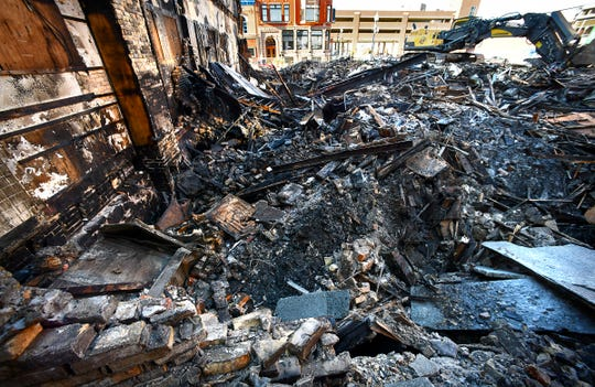 Rubble is all that remains at the site of the former Press Bar at the corner of Fifth Avenue and St. Germain Street Wednesday, Feb. 19, 2020, in downtown St. Cloud.