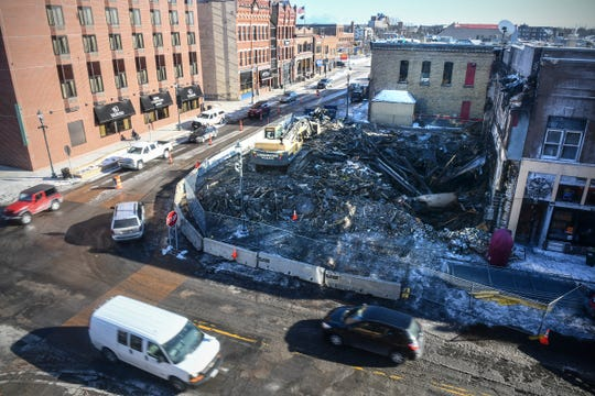 Traffic moves past the former Press Bar location at the corner of Fifth Avenue and St. Germain Street Wednesday, Feb. 19, 2020, in downtown St. Cloud.