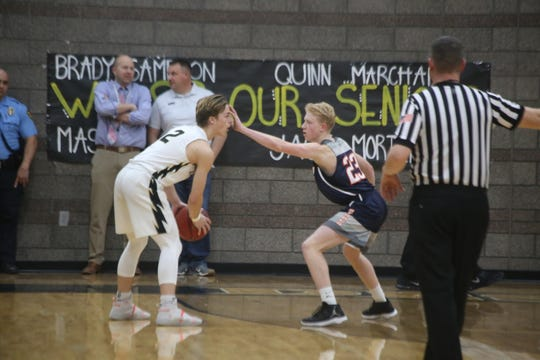 Desert Hills junior guard Peyton Holmes looks to break down the defense of Mountain Crest guard Myles Andrus during Desert Hills' 82-59 win in the first round of the 4A playoffs.