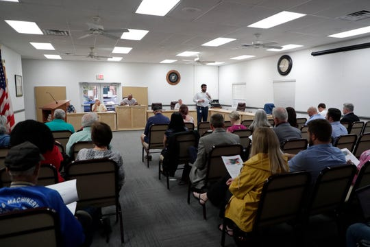 Joseph Oglesby, who works with Department of Economic Opportunity, holds a meeting for residents of Calhoun County to address their financial needs and concerns as they continue to recover from Hurricane Michael a year and a half later.