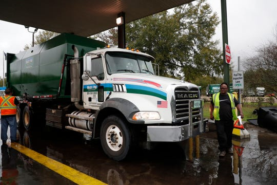 A Waste Pro garbage trucks pulls into the facility where it is checked for any maintenance or repairs needed before parking it for the day.