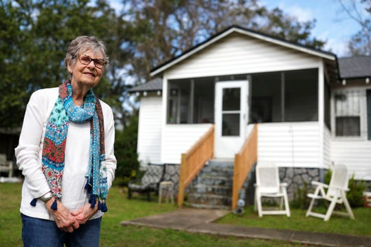 Ann Bannerman Camp, 90, stands in front of a  home located in Frenchtown. Camp's father, Robert Lee Bannerman, bought the property and built the home for John McBride and his wife. McBride's ancestors had been slaves of the Bannerman family's Iamonia plantation.