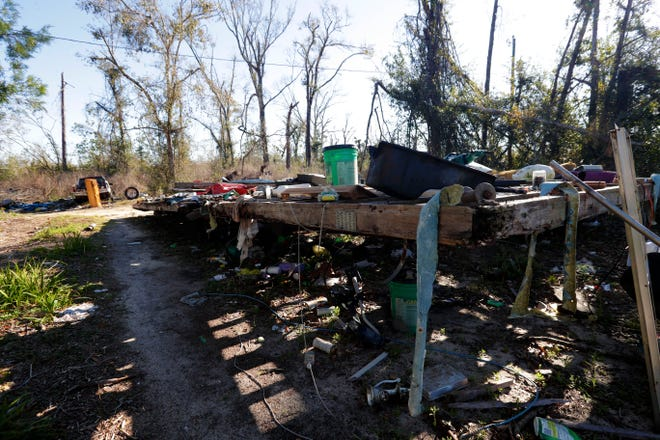 The foundation for what once was a mobile home, littered with debris and belongings after being ripped to shreds by Hurricane Michael in Oct. 2018.