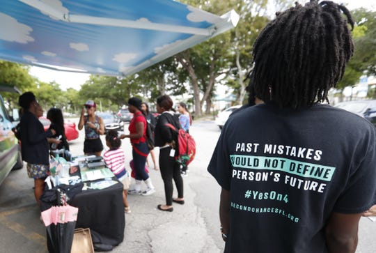 The Amendment 4 campaign successfully got Florida voters to support restoring felons' voting rights. But a new law requiring the payment of fines and other costs has kept many from registering.
