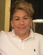 Celia Helm, 49, was reported missing on Monday. her body was found inside a car parked at the Walmart on West Tennessee Street