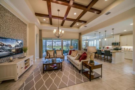 The spacious, gorgeous interior of a model home in the Serenoa Community.