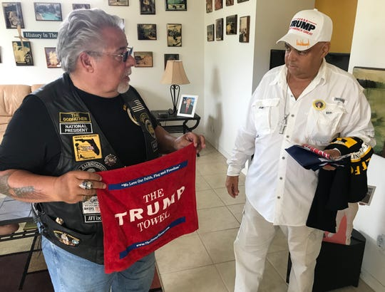 """Port St. Lucie resident Nelson Gibson, right, received a """"Trump Towel"""" from George Colella, National President of the group """"Bikers for 45,"""" on Tuesday, Feb. 18."""