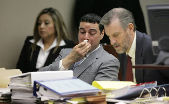 10/04/2010 David Marmolejo wipes his face as photos from the autopsy done on his mother Gloria Marmolejo's body are shown to the jury and those in the 210th District courtroom during the first day of his trial. Marmolejo, 31, is suspected of strangling and killing his mother, Gloria Huerta Marmolejo, 54, on July 25, 2009. Helen Edwards a walker found her body six days later in the desert near Santa Teresa.
