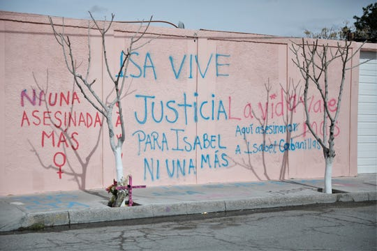 Messages calling for justice in the murder of Isabel Cabanillas are written on a pension building next to where she was found slain.