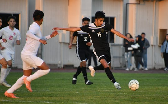 Channel Islands midfielder Enrique Tiscareno attempts a shot against Redondo Union in the CIF-Southern Section Division 2 quarterfinals on Tuesday night at Benefield Stadium. Channel Islands won, 2-0.
