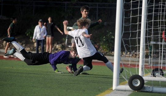 Odin Rosten slips a shot past a Vasquez player after getting around the goalie for one of his three goals during St. Bonaventure's 3-0 victory in a CIF-SS Division 7 quarterfinal game Tuesday.