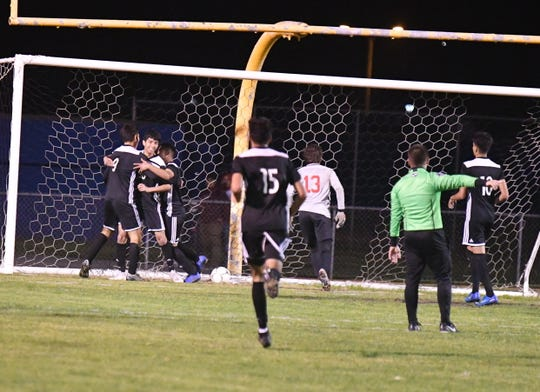 Channel Islands striker Jesus De La Cruz (far left) celebrates his goal against Redondo Union with his teammates in the CIF-Southern Section Division 2 quarterfinals on Tuesday night at Benefield Stadium. Channel Islands won, 2-0.