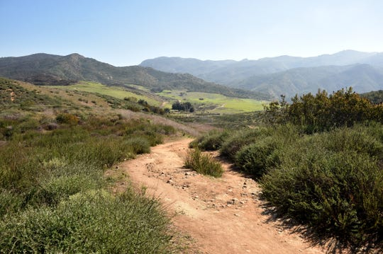 Dry grasses cover the hills along a trail at Rancho Sierra Vista in Newbury Park on Wednesday, Feb. 19, 2020.
