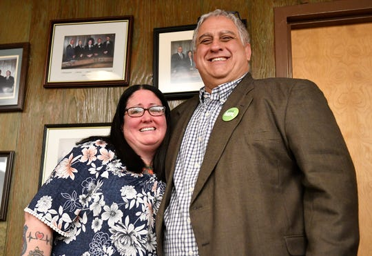 Commissioner Joseph Pepitone and Officer Sue Taylor pose for a photo during a special retirement ceremony for Taylor at the City Commission meeting on Tuesday, Feb. 19, 2020. Taylor's last day as an office is Feb. 28.