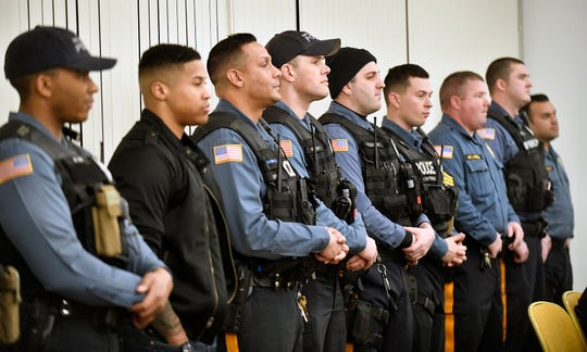 Members of the Millville Police Department line up during a special retirement ceremony for police officer Sue Taylor at City Hall on Tuesday, Feb. 19, 2020.