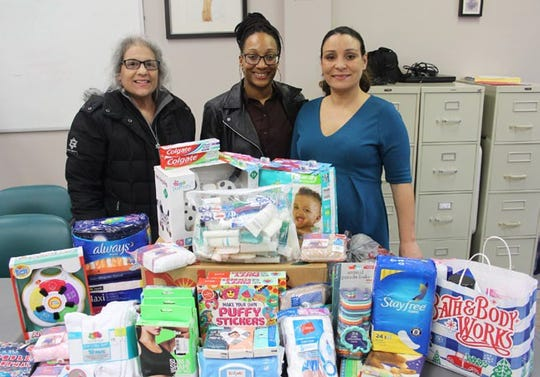(From left) Rosalie Forcinito, president, Zonta Club of Cumberland County, presents Daniesha Bradley, prevention specialist for SERV (Services Empowering Rights of Victims) at the Center for Family Services, and Jessica Rivera, domestic violence advocate, with donations from the club to help victims of domestic violence.