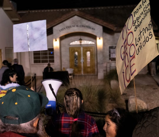Protestors and supporters wait outside at McFarland Veterans Community Center and Council Chambers on Tuesday, February 18, 2020 as McFarland's Planning Commission takes public comment on a plan that would convert two state prison facilities into for-profit immigration detention centers.