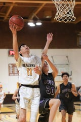 Golden West's Matt Delreal shoots against Madera South in a Central Section Division IV high school boys basketball playoff game on Tuesday, February 18, 2020.