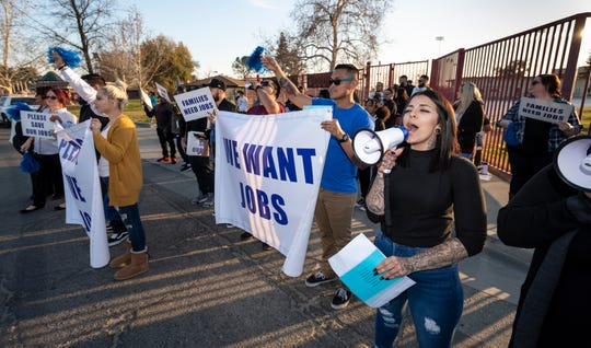 Krystin Day, right, and other GEO supporters stand across the street from protesters at McFarland Veterans Community Center and Council Chambers on Tuesday, February 18, 2020. Protesters opposed a plan that would convert two state prison facilities into for-profit immigration detention centers. The planning commission met later that day to hear comment before voting on the matter.