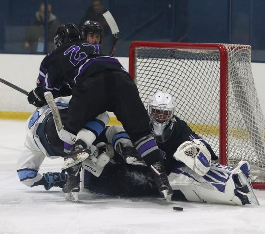 John Jay-Cross River goalie Nick Petrella keeps his eyes on the puck after making one of his 42 saves in a 5-2 loss to Division 1 top-seed Suffern Feb. 18, 2020 at Sport-O-Rama. John Jay-CR is the top seed in Division 2. It went 17-2-1 during the regular season.