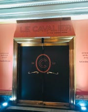 New signs for the Le Cavalier restaurant at the Hotel du Pont in Wilmington.