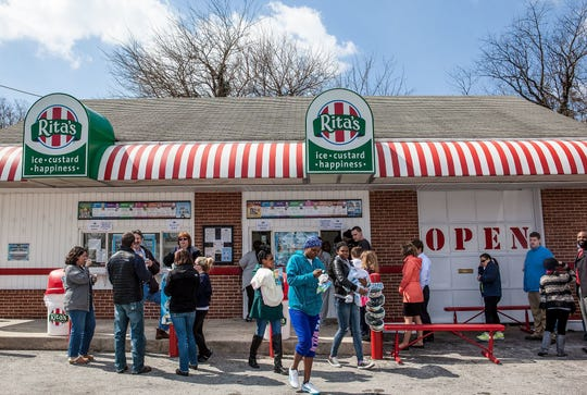 The traditional water ice giveaway at Rita's Italian Ice draws a crowd on the first day of spring each year.