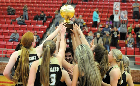 The Archer City Lady Wildcats celebrate their 46-32 victory against De Leon in a Region II-2A bi-district matchup in Mineral Wells on Tuesday, Feb. 18, 2020.
