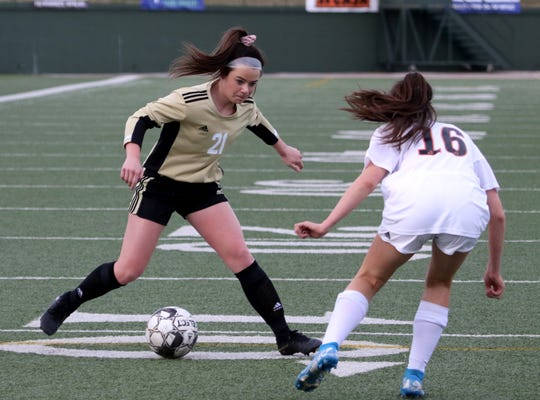 Rider's Aubrey Glidewell dribbles in the match against Aledo Tuesday, Feb. 18, 2020, at Memorial Stadium.