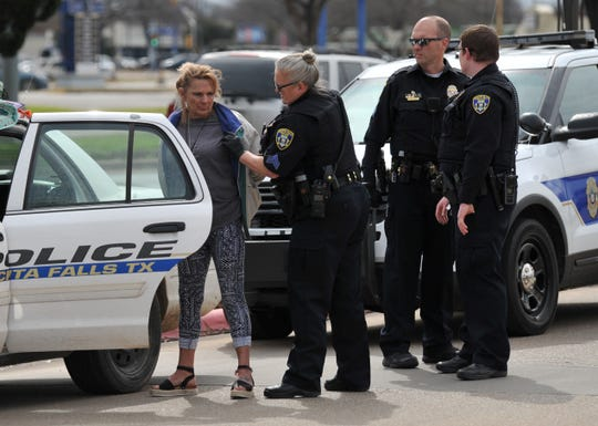 Wichita Falls police detain a possible suspect that was involved in an assault, Wednesday afternoon in the parking lot of the Olive Garden.
