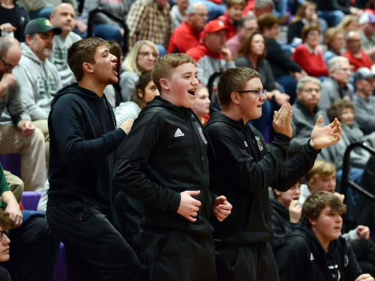 New Lexington's reserves celebrate as time winds down in the fourth quarter of a 53-43 win against Sheridan on Tuesday night in a Division II sectional game at Logan High School.