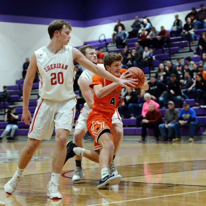 Logyn Ratliff drives into the lane during the fourth quarter of New Lexington's win against Sheridan in a Division II sectional game last season. Ratliff is one of several returning players for the Panthers, who have high aspirations.