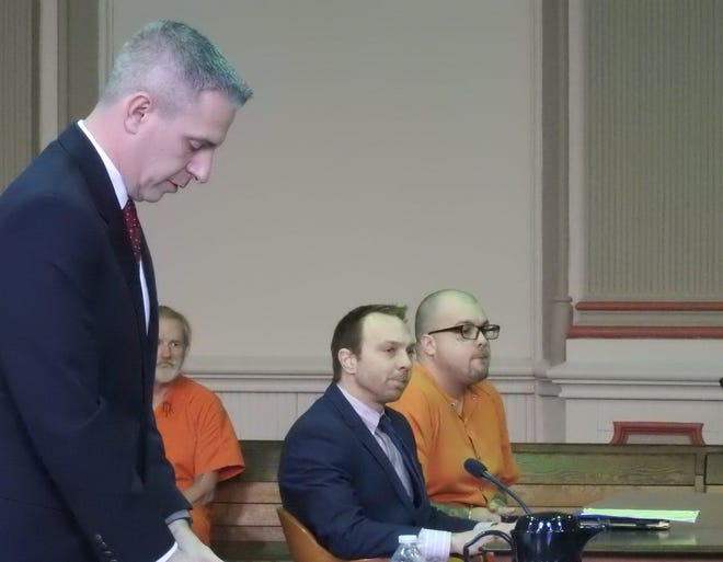Assistant Prosecutor Ron Welch reads the memorandum related to the charges against William Dufran in court Wednesday. Defran was sentenced to four years in prison after failing to register his address and removing his ankle monitor to leave his restricted perimeter.