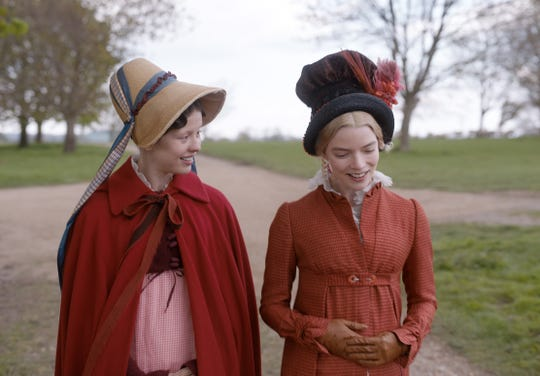 "Mia Goth (left) as ""Harriet Smith"" and Anya Taylor-Joy (right) as ""Emma Woodhouse"" in director Autumn de Wilde's EMMA., a Focus Features release.  Credit : Focus Features"