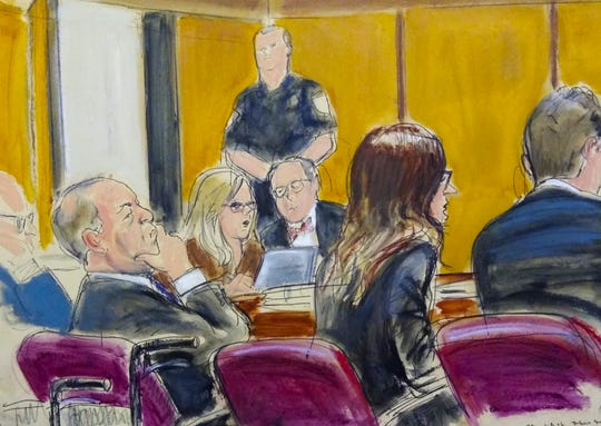 In this courtroom sketch, Harvey Weinstein, left, sits with his attorneys in Manhattan Supreme Court as the jury deliberates in his sex crimes trial Feb. 19 in New York.