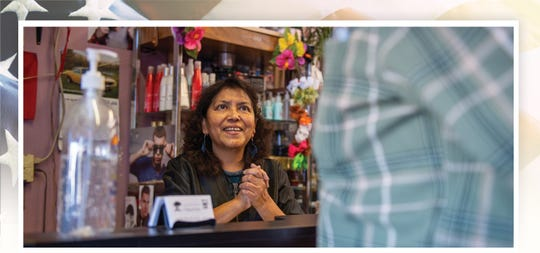 Fausta Ibarra, 59, owner of Tropical Cuts Beauty Salon in Salinas, California, greets a customer early morning on Feb. 7, 2020.