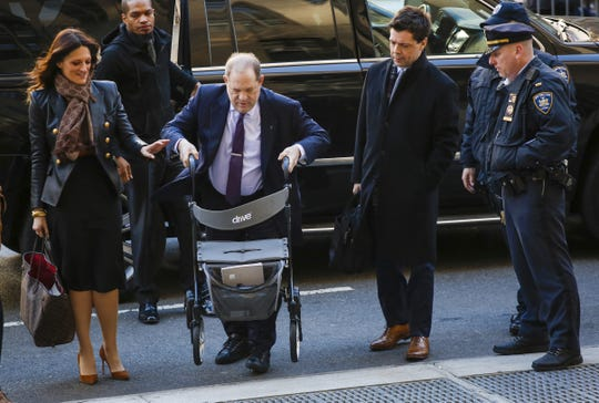 Harvey Weinstein arrives at the courthouse, flanked by lawyers Donna Rotunno and Damon Cheronis, on Feb. 19 in New York City during jury deliberations in his sex crimes trial.